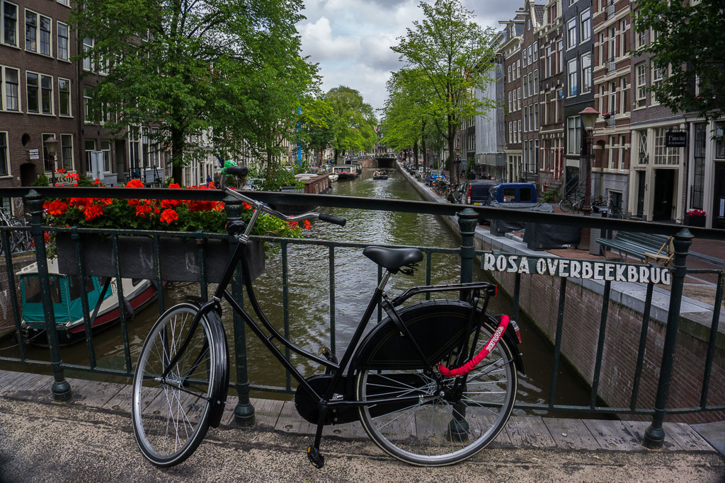 The Two Drifters beautiful flowers canal and bike in Amsterdam www.thetwodrifters.net