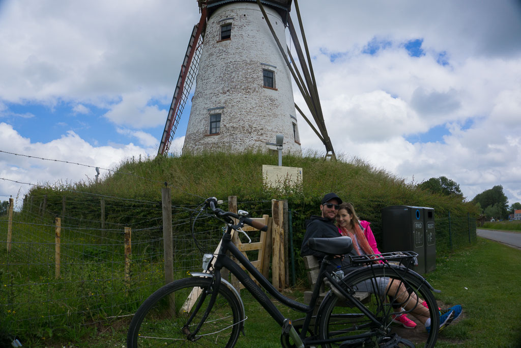 The Two Drifters stopping for lunch near a windmill in Belgium, www.thetwodrifters.net