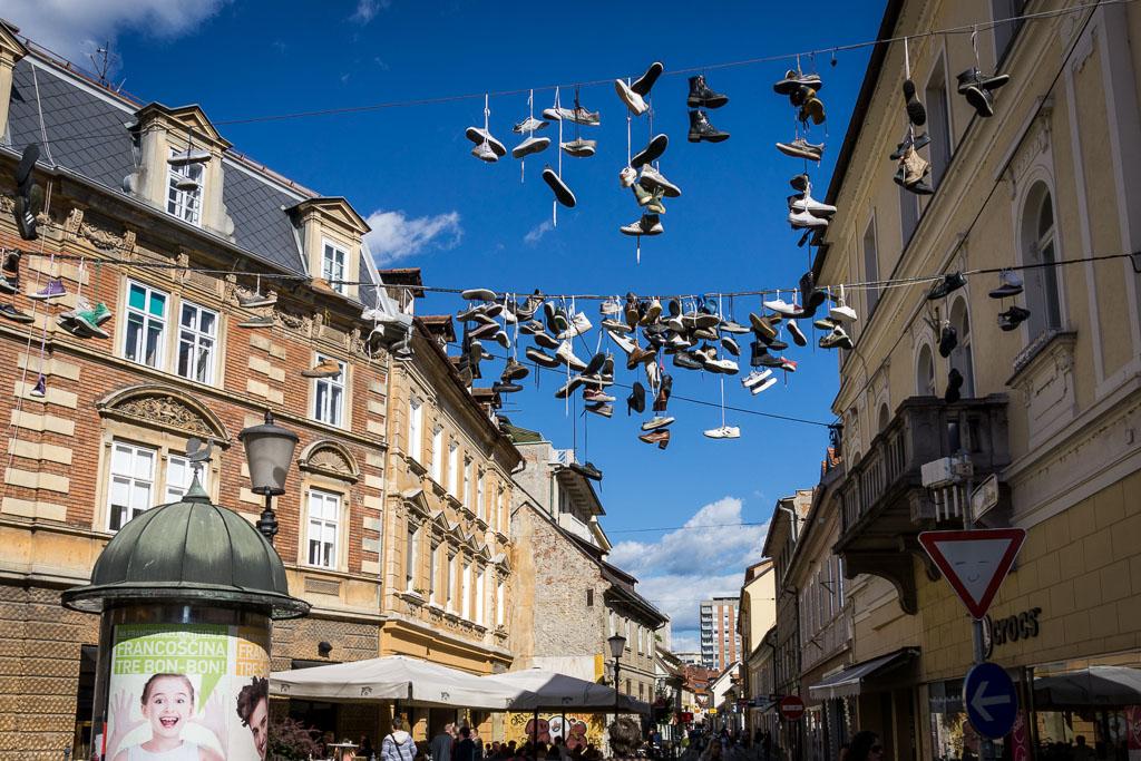Shoes hanging - Ljubljana, Slovenia, The Two Drifters www.thetwodrifters.net